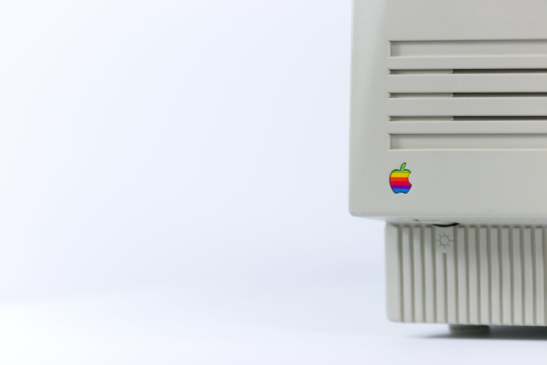 gray device with apple logo on white surface